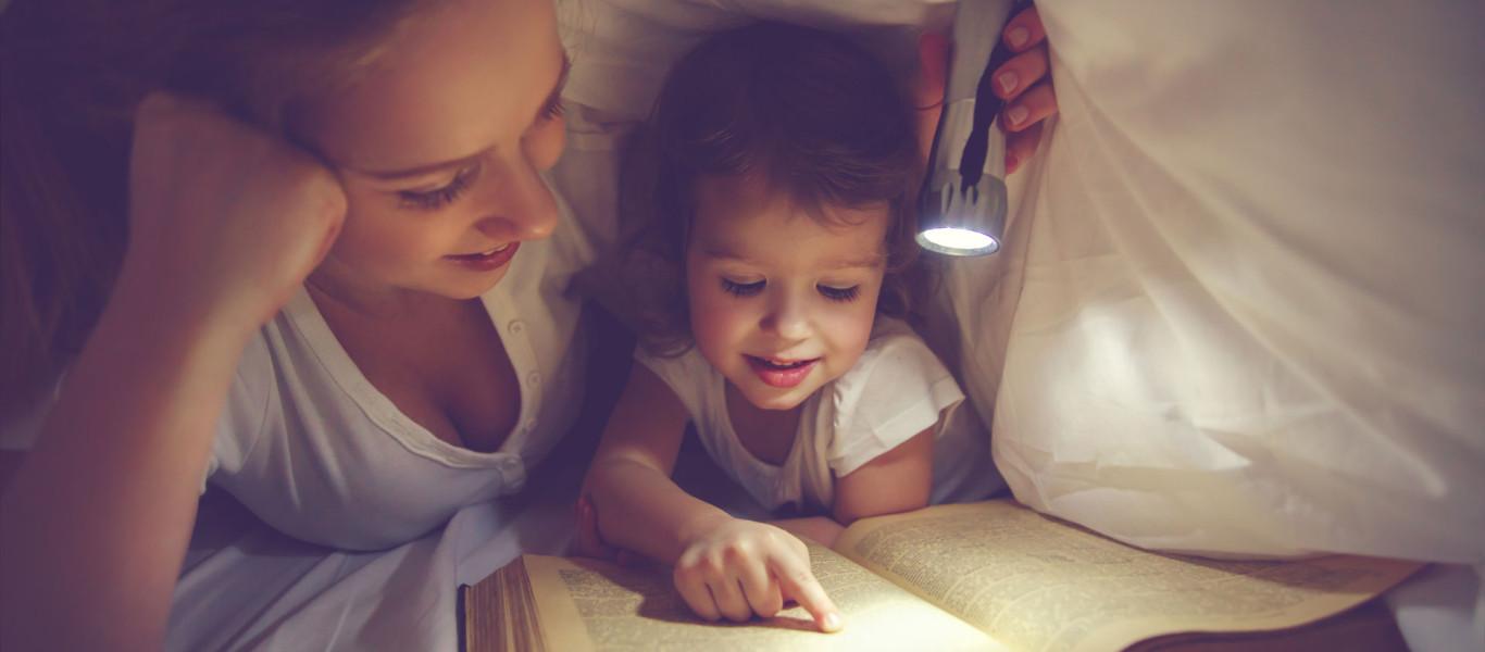 bigstock-Family-Reading-Bedtime-Mom-An-120539375